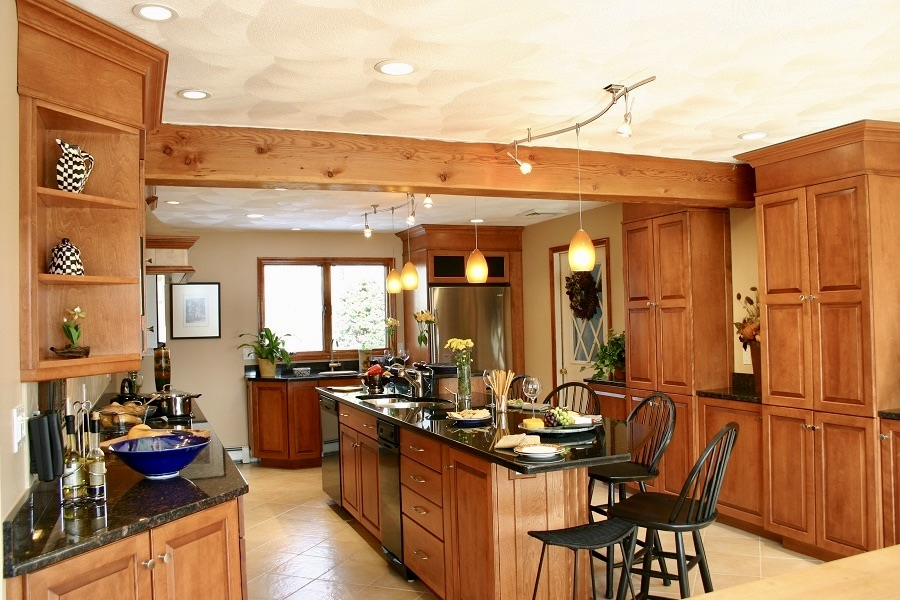 Cherry kitchens create a warm, inviting atmosphere for any house.
