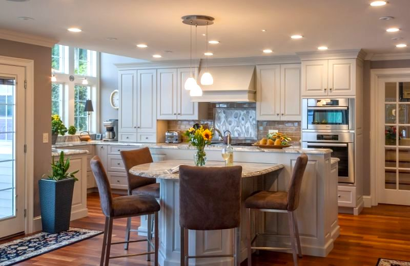 Grey accents compliment the white cabinets in this two toned kitchen.