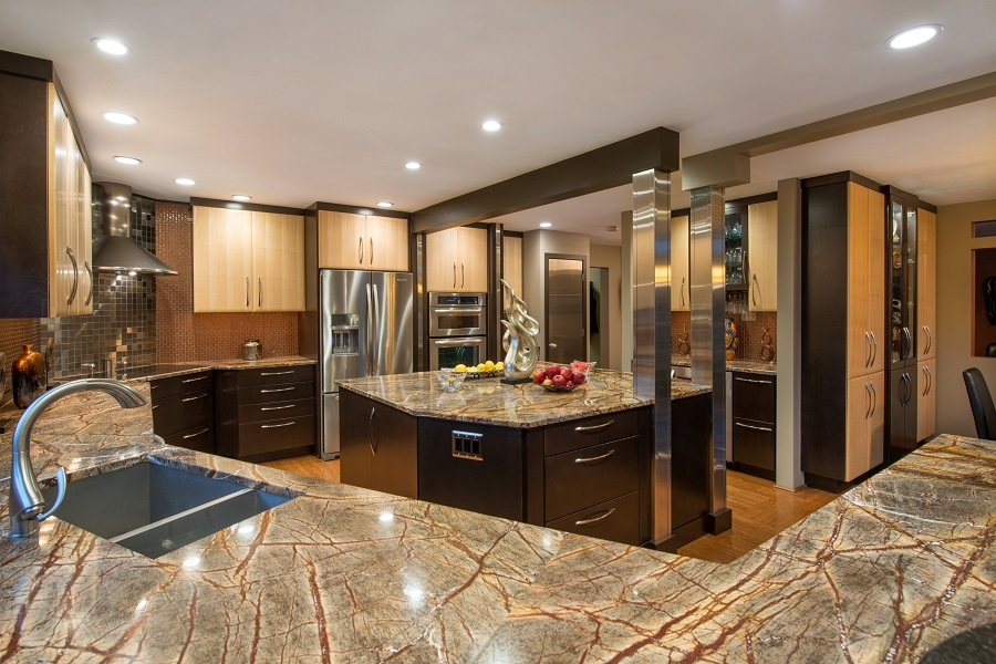 Black cabinets meet this artistic grey countertop with brown accents.