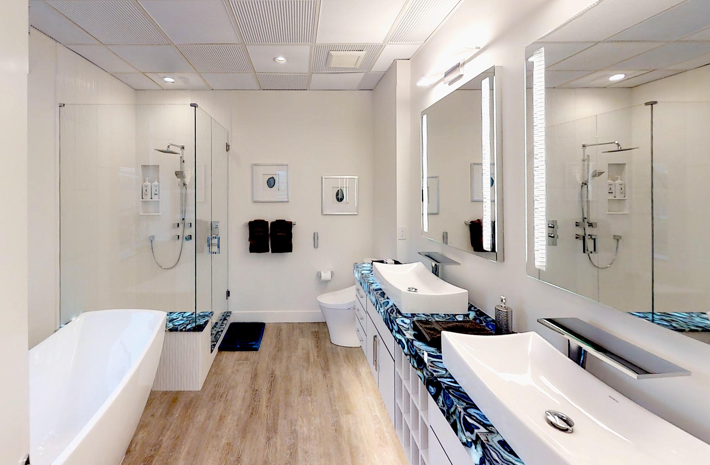 A white bathroom meets a stunningly original countertop.
