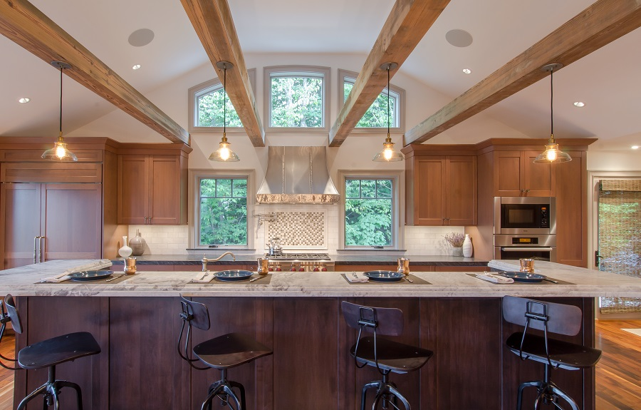 Bold clean lines with dark wood tones accent the unique rafters in this kitchen.