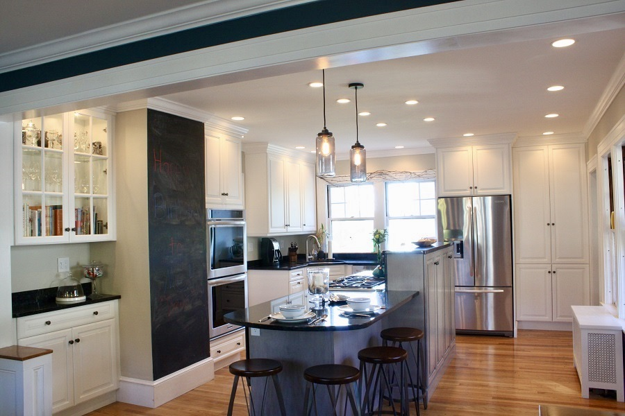 This kitchen feels anything BUT medium. Peninsula that seats 4, a chalkboard and glass cabinets transform this kitchen!