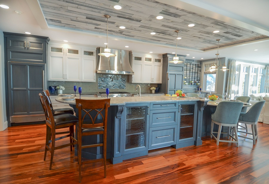 This transitional kitchen combines beach elements with white cabinets.