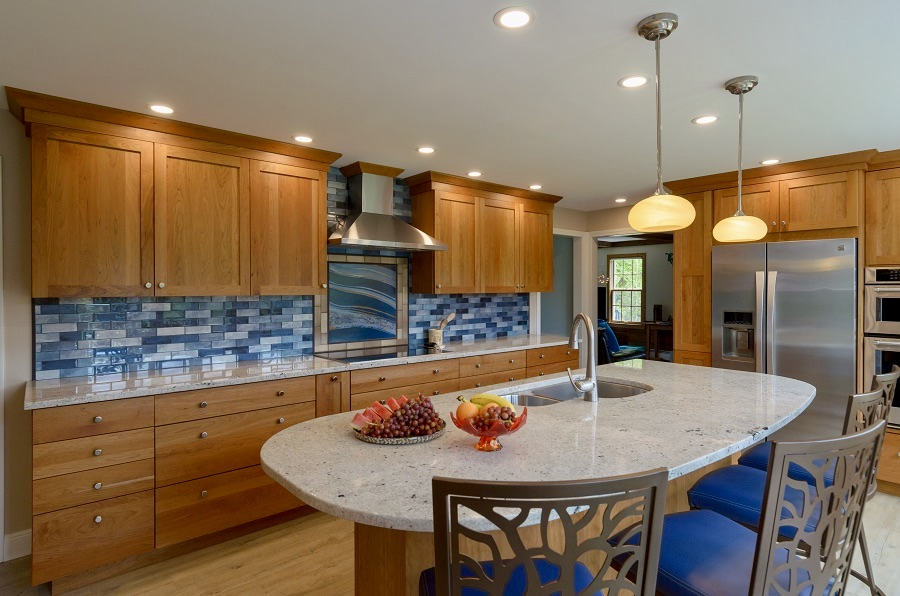 A blue mosiac backsplash is the center piece of this cherry kitchen.