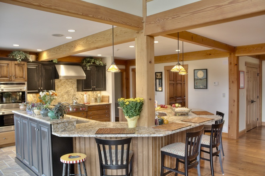 A wide, open country kitchen with an island and medium brown tones.