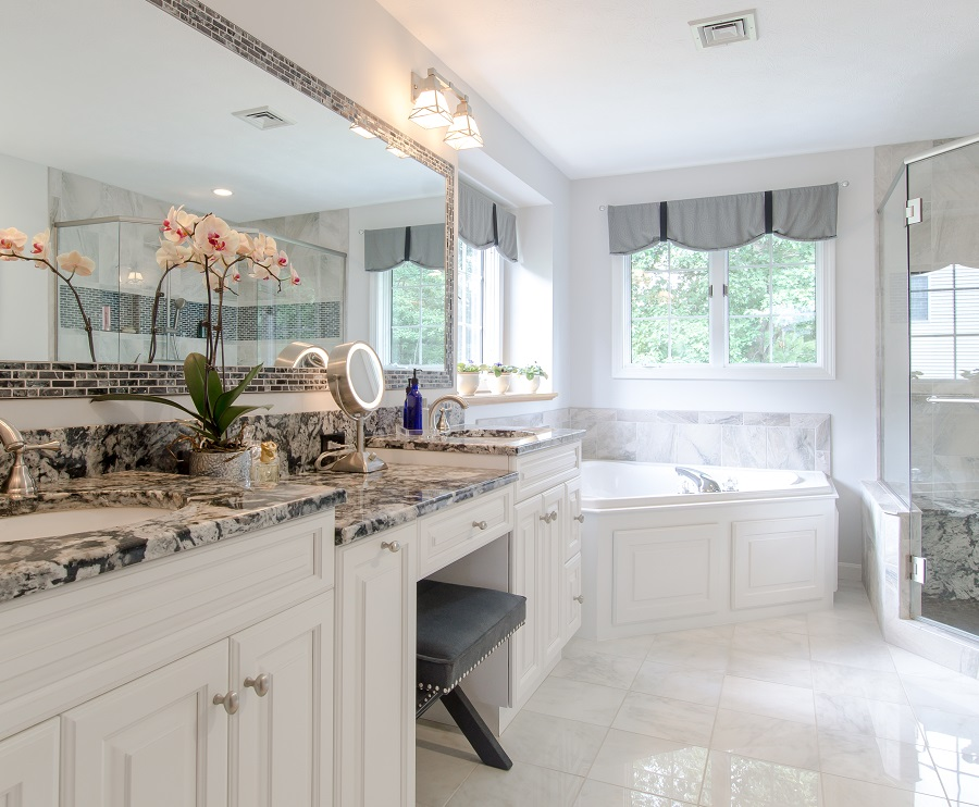 Heavenly white cabinets brighten this personal sanctuary. Ask about our Dream Bathroom remodelling!