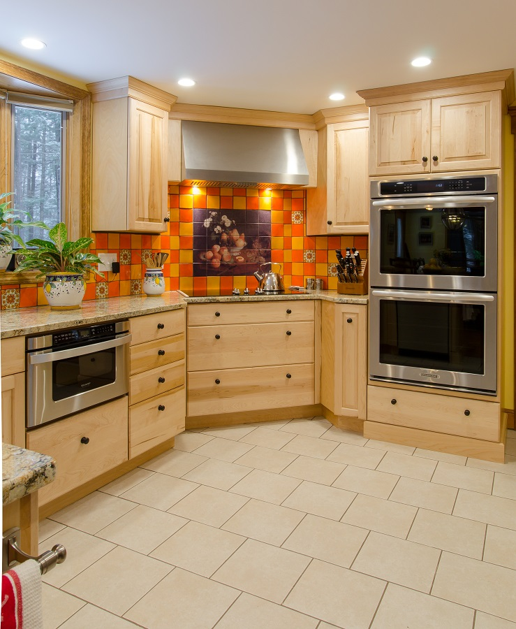 This bold yellow and orange tile backsplash makes an exciting statement piece.