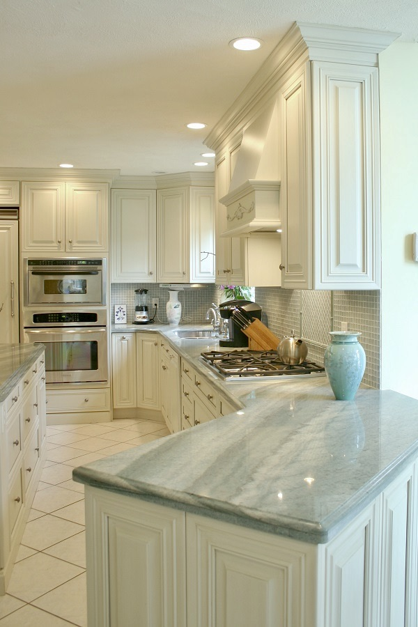 Grey-Blue countertops accent this clean white kitchen.