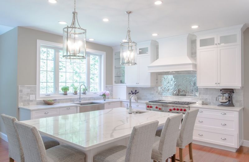 Heavenly white cabinets are paired with softer accents of light grey to evoke a calming experience.