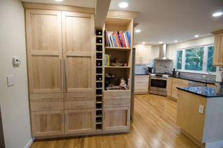 A vertical wine bar is an innovative touch by Dream Kitchens!
