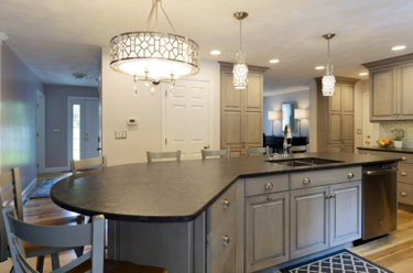 This elegantly designed kitchen features an island that seats up to 6 guests! Hanging lights brighten up this space while creating a sophisticated touch.