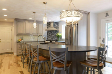 The black and white mosiac adds a stunning element while using the kitchens new color palette.