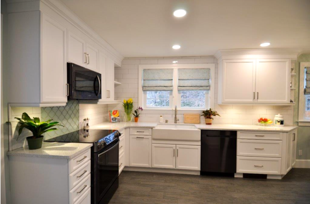 A new white kitchen remodel with green accents